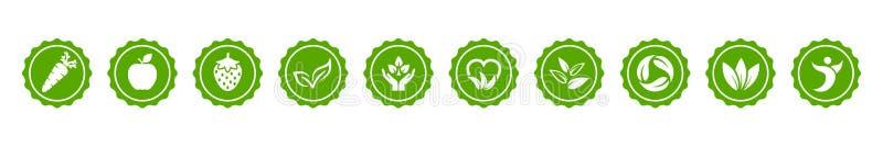 Значки кнопки Vegan зеленые био устанавливают с морковью, яблоком, клубникой и листья подписывают – вектор иллюстрация вектора