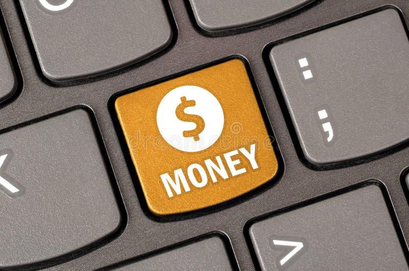 Значок денежного доллара на клавиатуре стоковая фотография