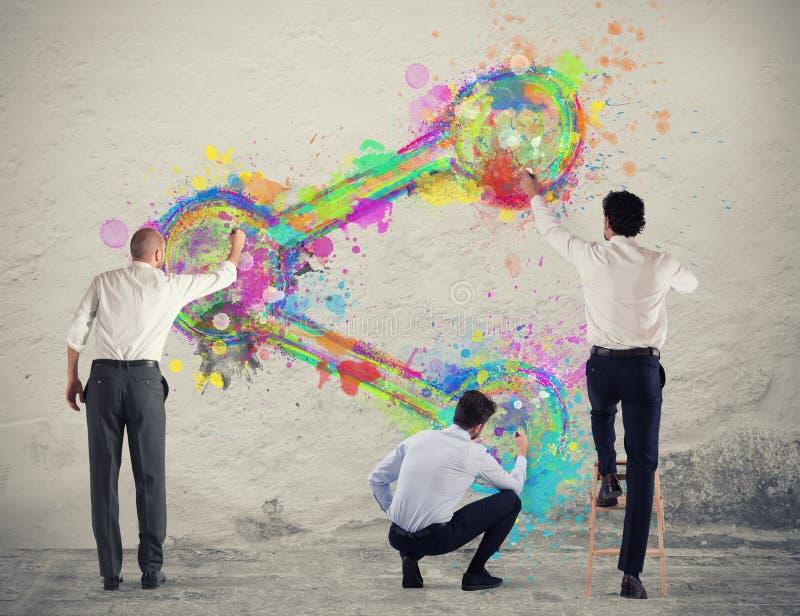 Значок доли краски человека дела на стене стоковая фотография