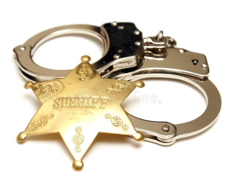 значок надевает наручники шериф стоковое изображение rf
