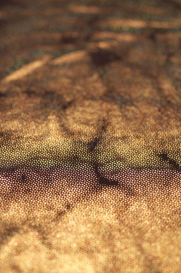Золотая блестящая текстура ткани стоковое фото rf