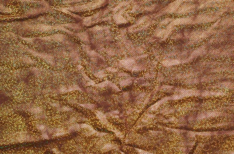 Золотая блестящая текстура ткани стоковые фото