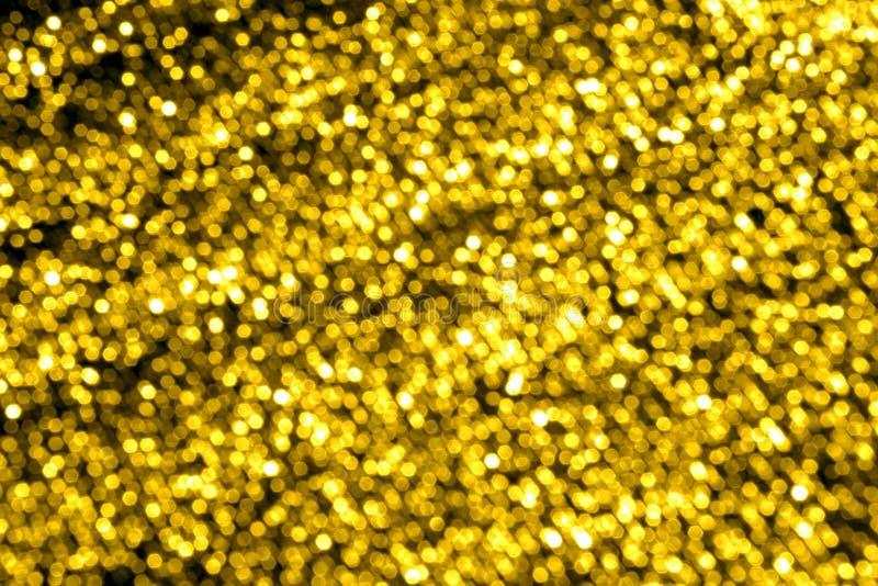Золотая запачканная слепимость для предпосылки Влияние Bokeh стоковая фотография rf
