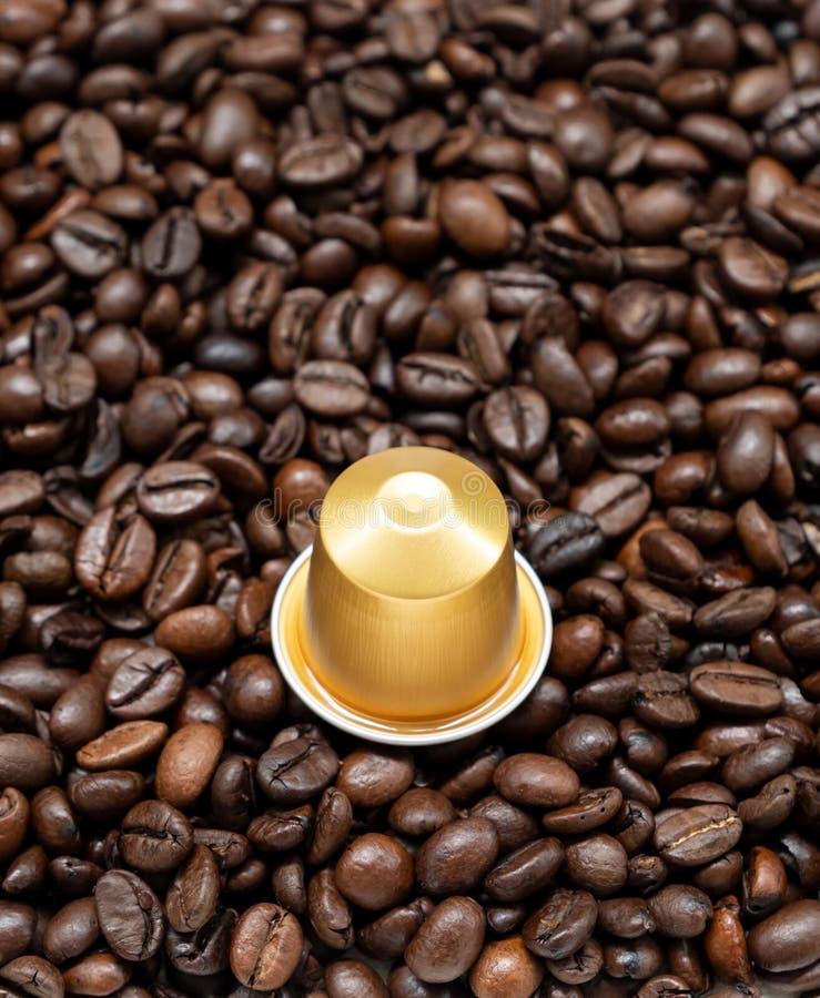 Золотая капсула кофе стоковое изображение