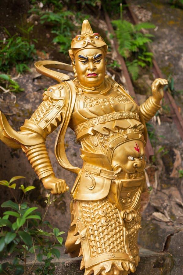 Золотая статуя в монастыре в Гонконге стоковая фотография rf