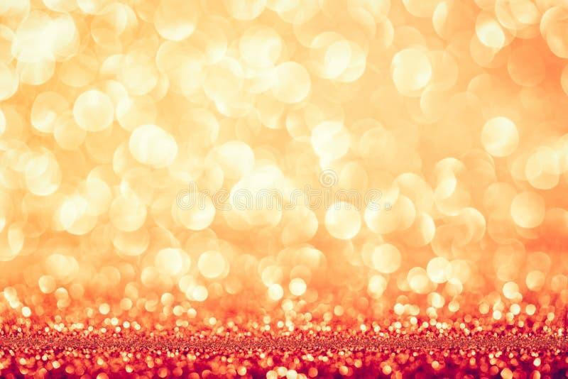 Золотая glittery предпосылка праздника bokeh стоковые изображения