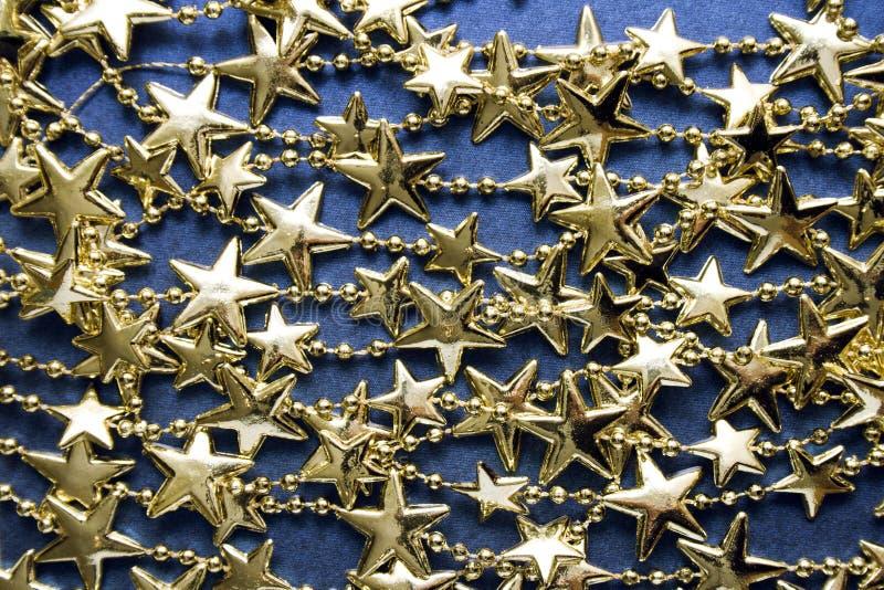 Золотистая звёздная предпосылка стоковое фото rf