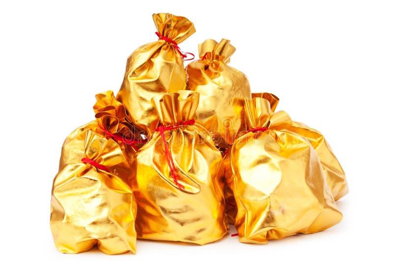 Золотистые вкладыши вполне товаров стоковое фото rf