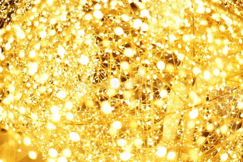 Золотое bokeh света СИД запачкало абстрактную предпосылку картины стоковое фото