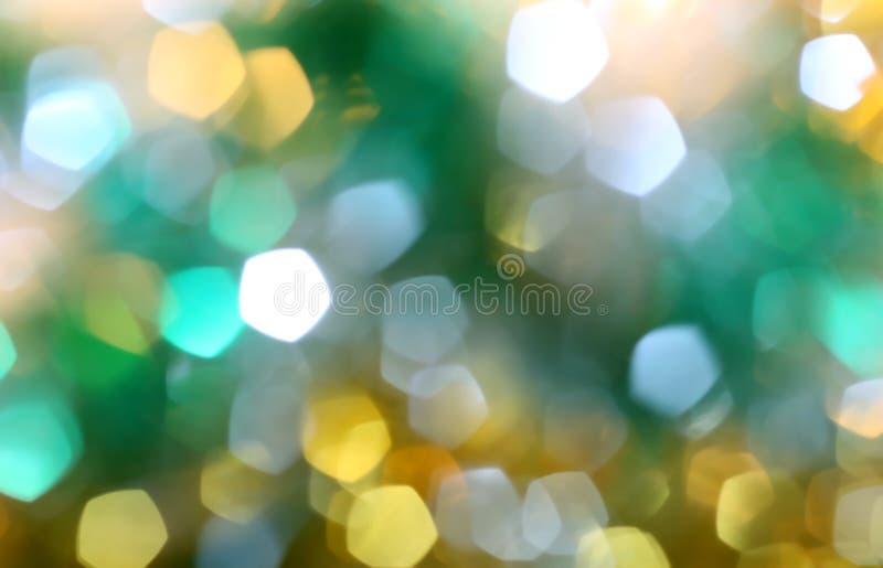 золотой и зеленый размытый фон, дефокусировка, неон, праздник, золото, желтый, рождество, место, эффект свечения, вечеринка, новы стоковая фотография rf