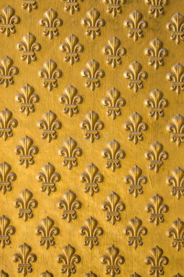 Золотой символ короля Fleur de lis стоковая фотография rf