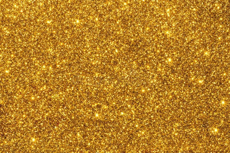 Золотой яркий блеск для текстуры или предпосылки стоковые изображения