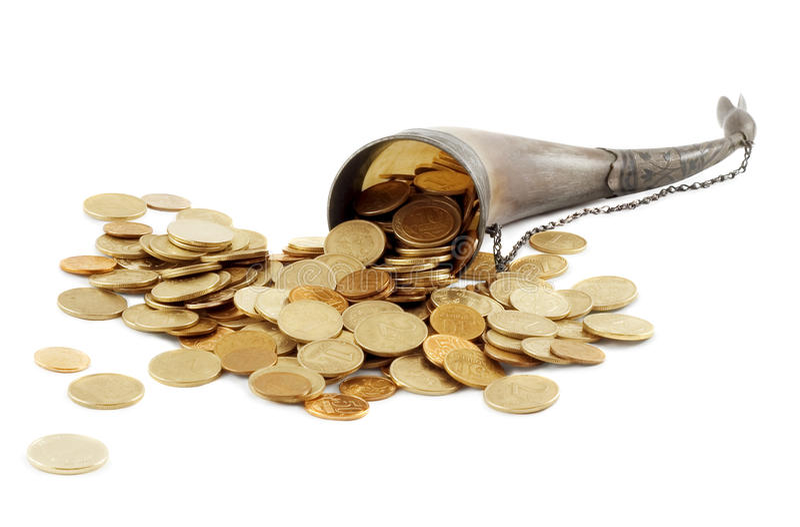 золото изобилия монетки косточки полное стоковые фото