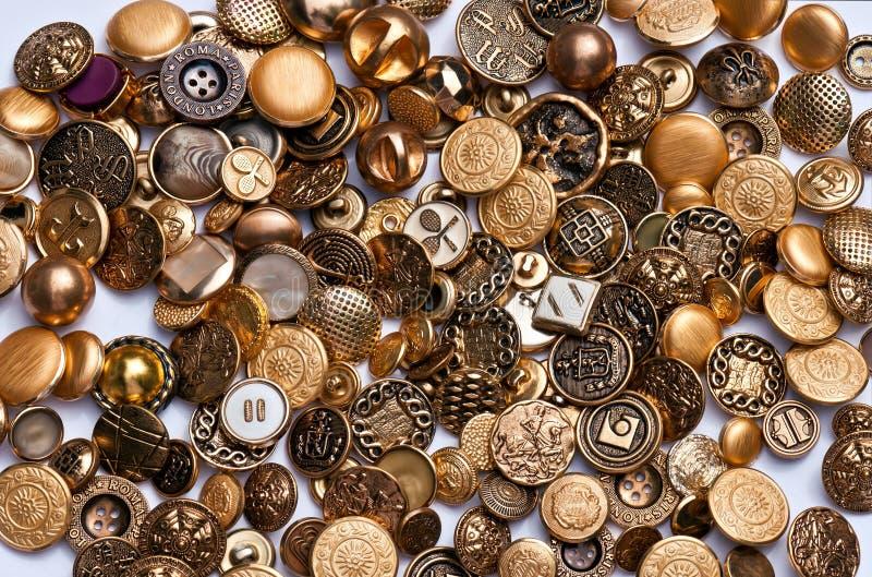 золото латунных кнопок стоковое изображение
