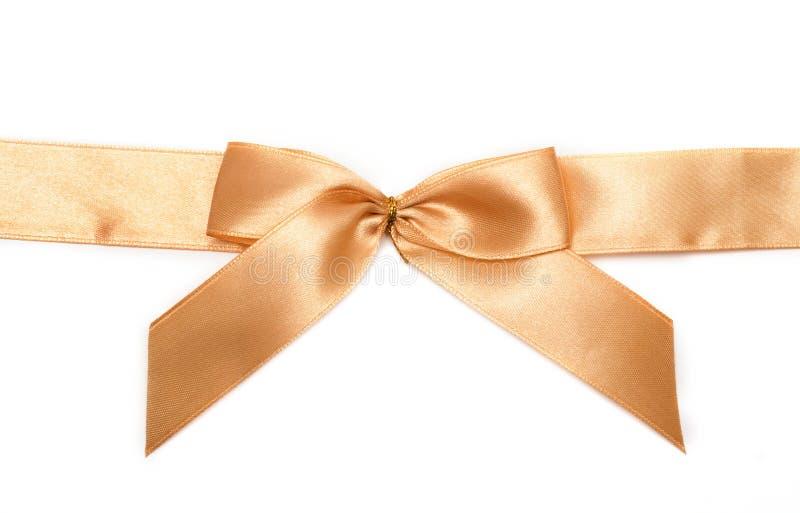 золото подарка смычка стоковая фотография