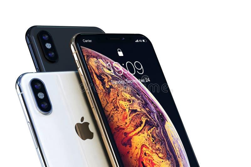 Золото IPhone Xs, серебр и серый цвет космоса на белом конце-вверх стоковая фотография rf