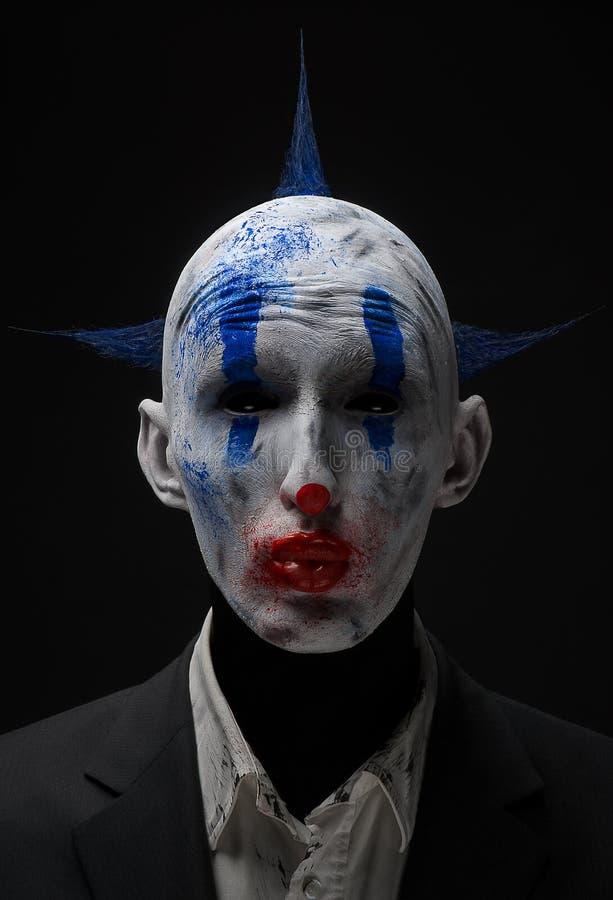 Зомби клоуна шальные голубые в куртке стоковое фото