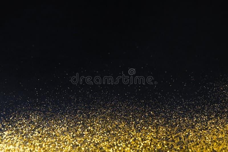 Золотая граница текстуры песка яркого блеска на черной, абстрактной предпосылке стоковое фото rf