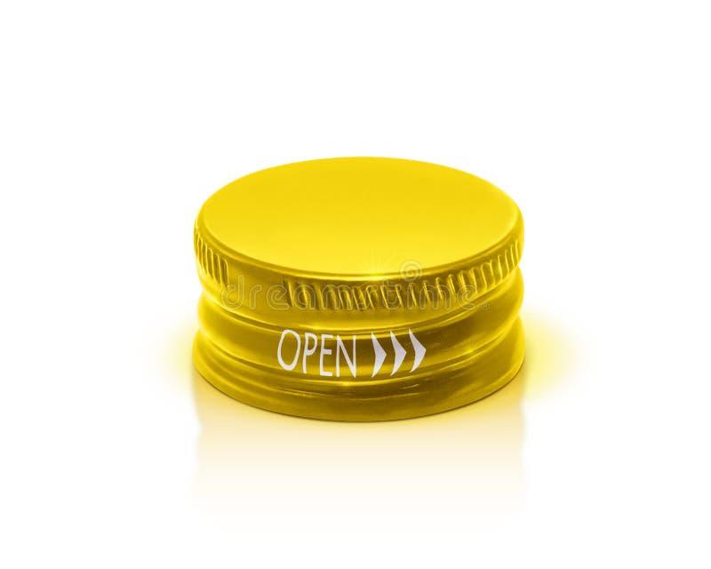 Золотая крышка бутылки изолированная на белой предпосылке стоковые изображения rf