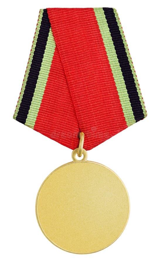Золотая медаль на белизне стоковые фото
