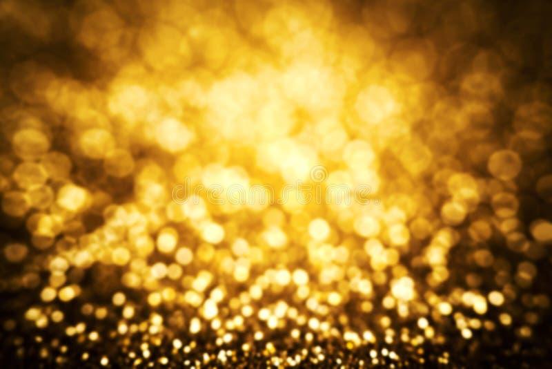 Золотая предпосылка конспекта рождества, праздничная карточка, яркий блеск золота стоковое фото