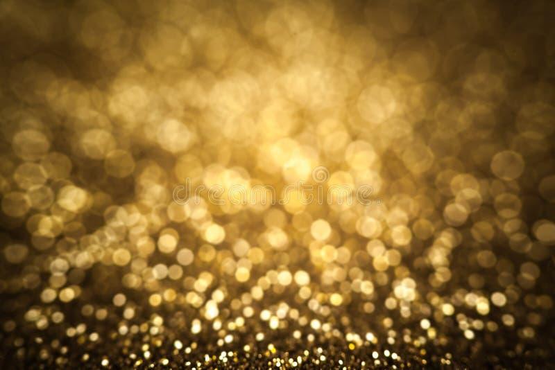 Золотая предпосылка конспекта рождества, праздничная карточка, bokeh золота стоковая фотография