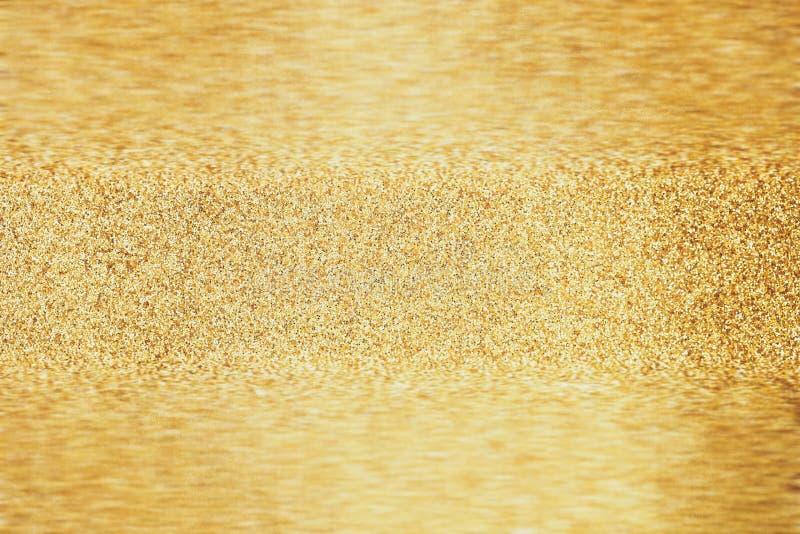 Золотая предпосылка grunge яркого блеска стоковое изображение