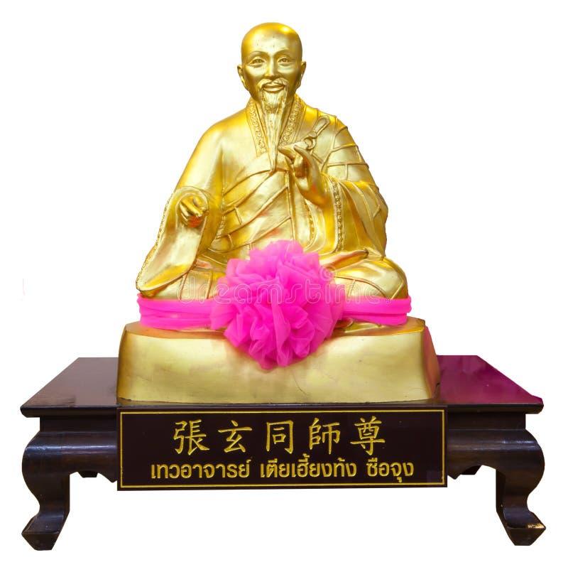 Золотая статуя китайского бога изолированного на белой предпосылке стоковые изображения