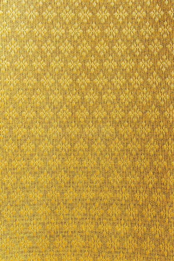 Золотая тайская silk предпосылка картины ткани стоковые фото