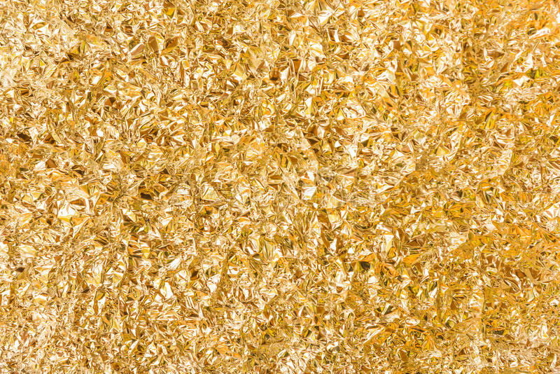 Золотая текстура алюминиевой фольги стоковые изображения