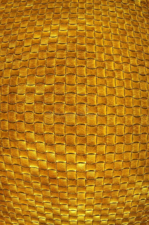 Золотая текстура кожаного заплетения предпосылка золота luxuriousl стоковые фото