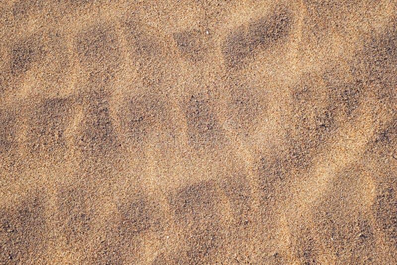 золотистая текстура песка стоковые изображения