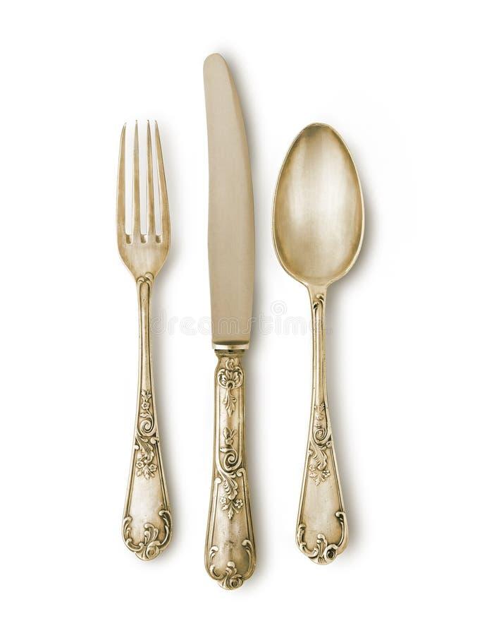 Золотистый комплект cutlery стоковая фотография