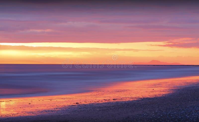Золотой заход солнца на пляже стоковое фото rf