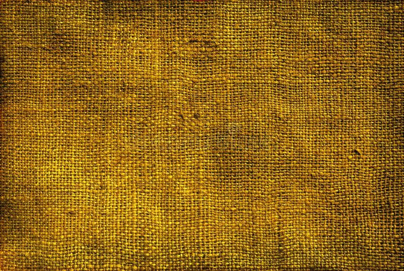 Золото, бронзовая предпосылка текстуры мешковины стоковое фото
