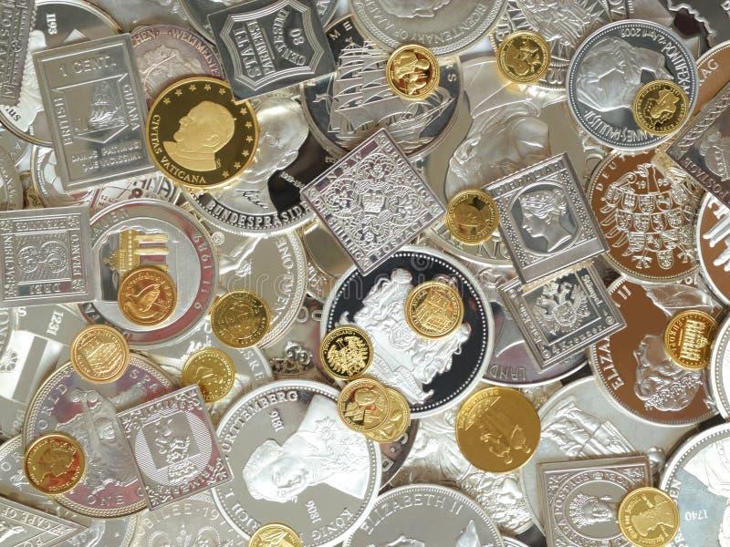 Золото и серебряные монеты миллиарда стоковое изображение rf