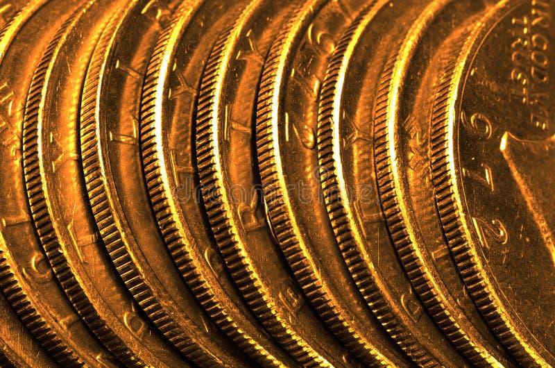 Золотые монетки и бары стоковая фотография