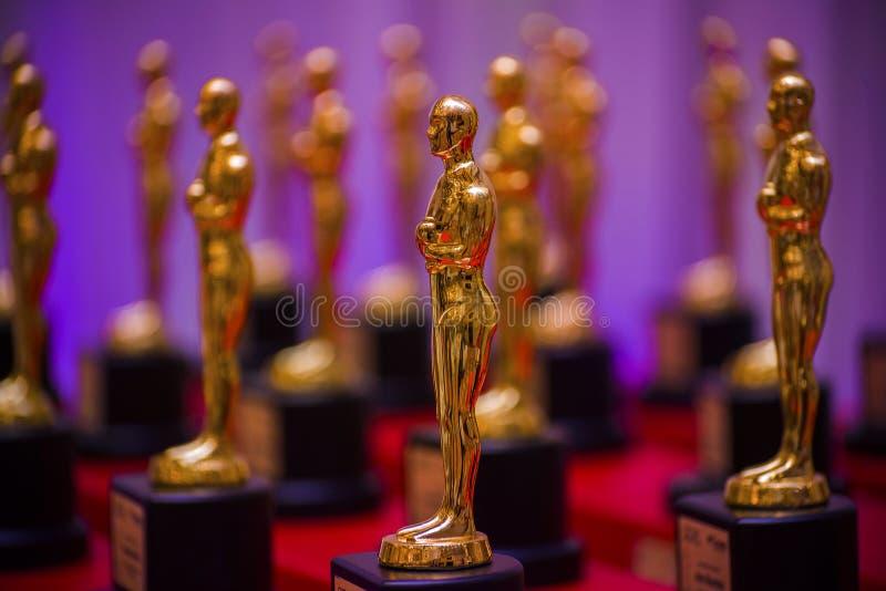 Золотые призовые статуи стоковое фото