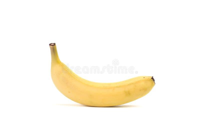 Зрелый желтый банан над белой предпосылкой стоковые фотографии rf
