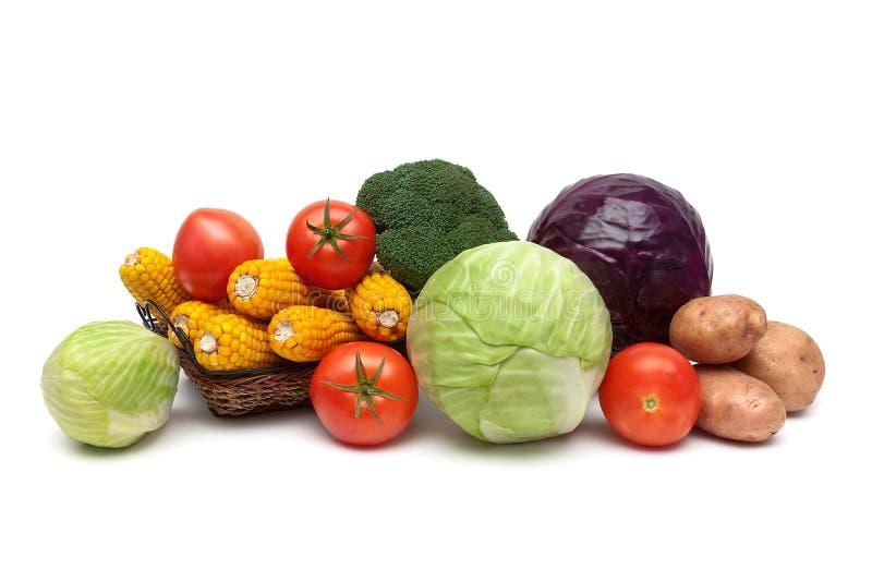 Зрелые свежие овощи на белой предпосылке стоковое фото