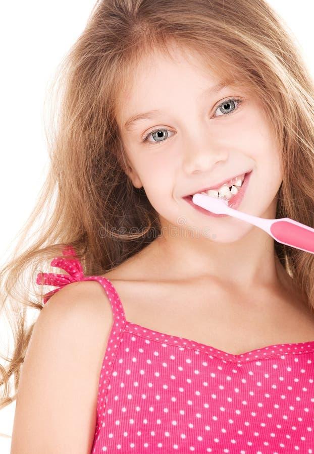 зубная щетка девушки счастливая стоковое изображение