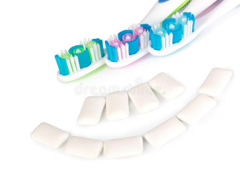 зубные щетки жевательной резины стоковое фото rf