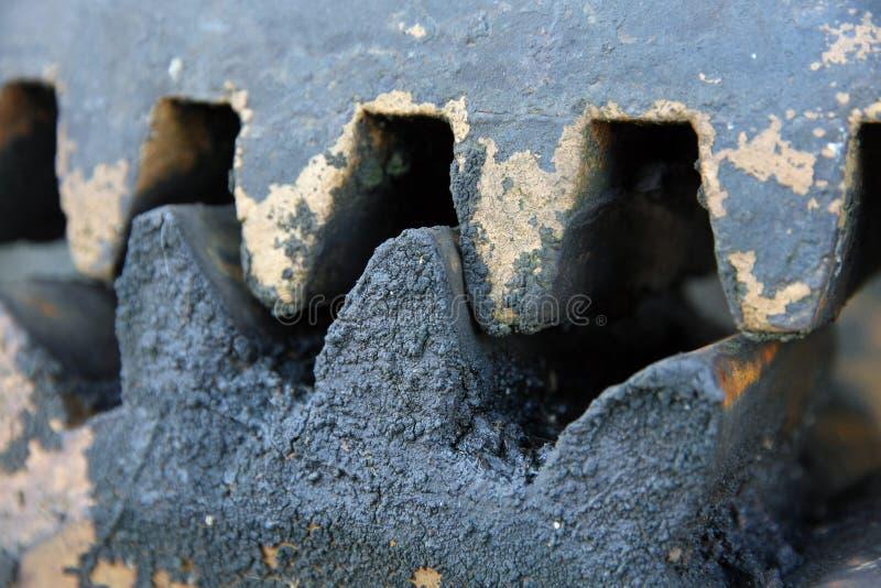 Зубы шестерни с черным промышленным тавотом стоковое изображение rf