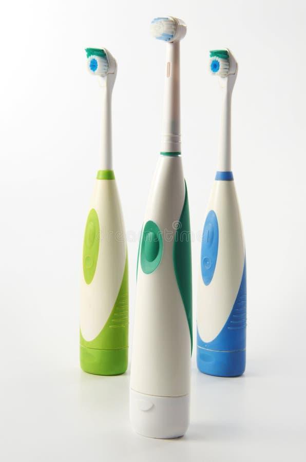 зуб щетки электрический стоковые фото