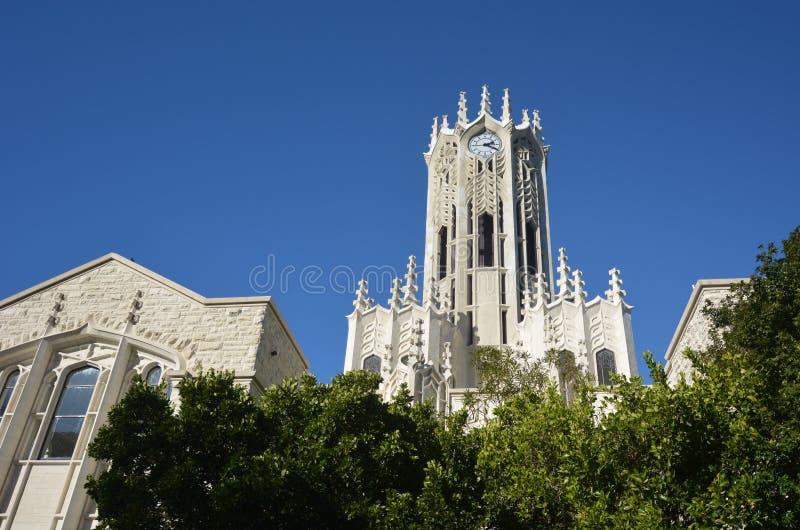Здание башни с часами университета Окленда стоковые изображения