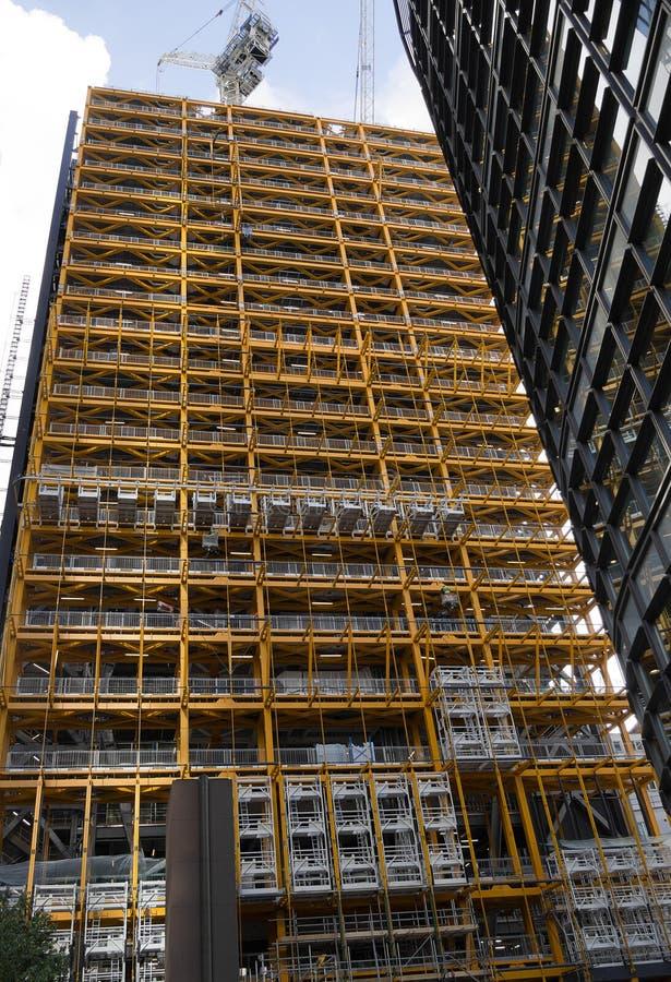 Здание, строительная площадка - небоскреб города стоковое фото rf