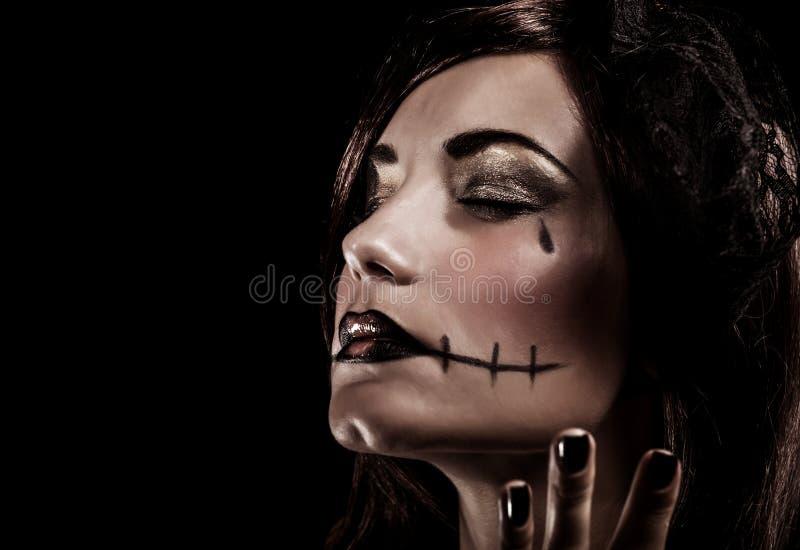Злая ведьма на черной предпосылке стоковые изображения