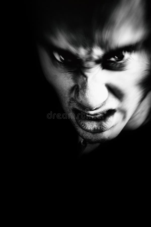 Злая сторона страшного человека стоковое фото