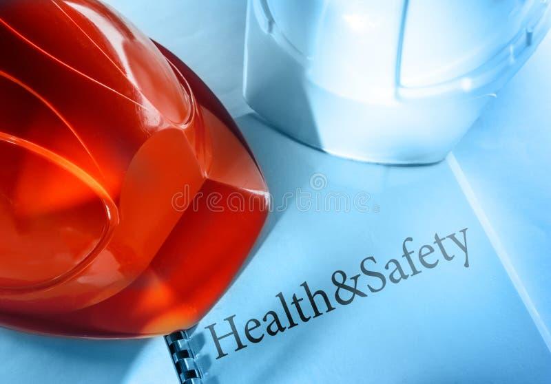 Здоровье и безопасность с шлемами стоковое изображение rf