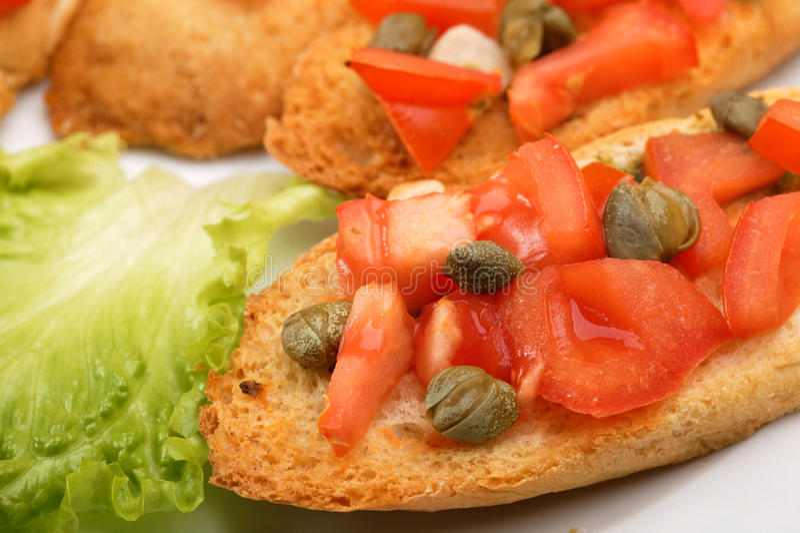 Здравицы с томатами стоковое фото rf